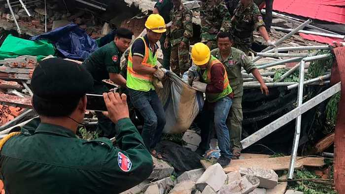 Seven-storey Cambodian collapses, killing three and trapping others