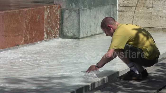 Residents in Spain use fountains to cool down amid European heatwave