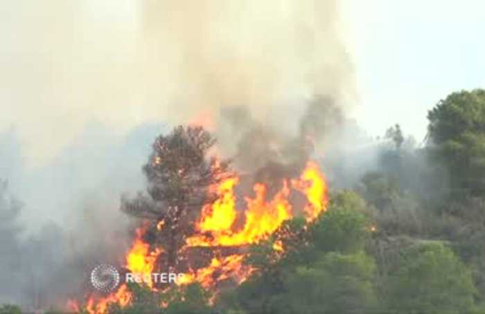 Spain wildfire threatens to burn up to 50,000 acres