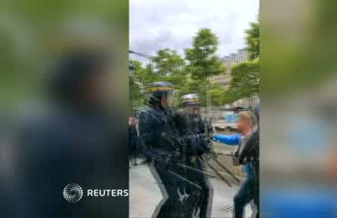 Police officer punched to ground on Champs Elysees after Bastille Day parade