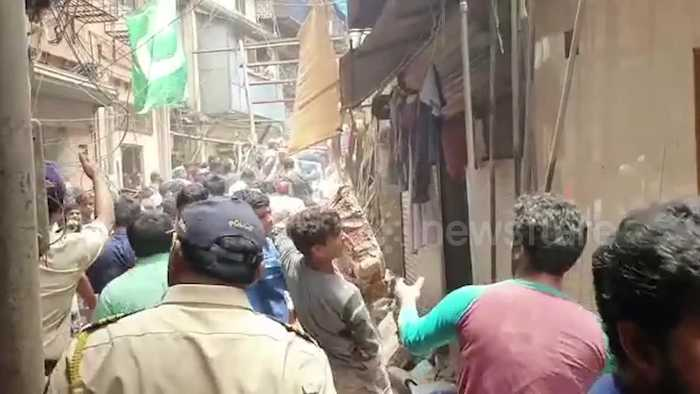 At least four dead and dozens still trapped in Mumbai building collapse