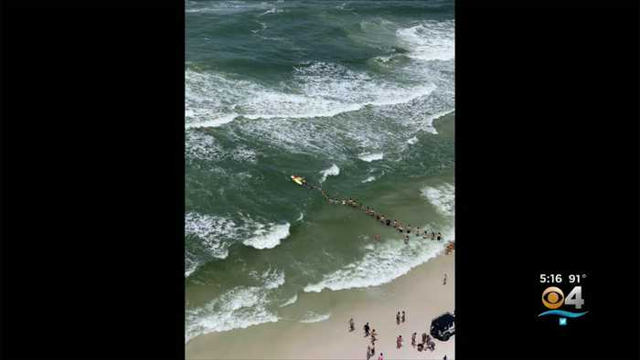 Beachgoers Form Human Chain To Rescue Bathers Caught In Rip Current