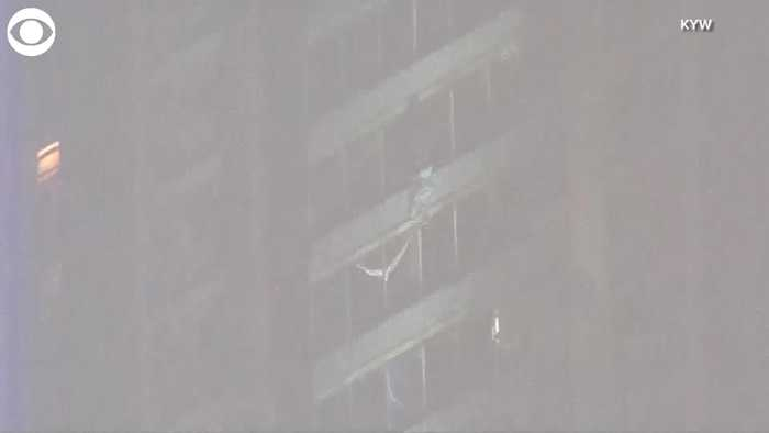 WEB EXTRA: Man Climbs Down Building To Escape Fire