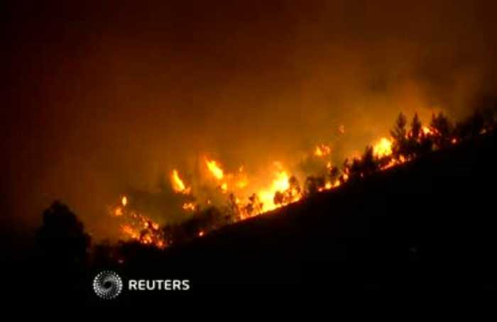 Villagers, firefighters battle huge blazes in Portugal