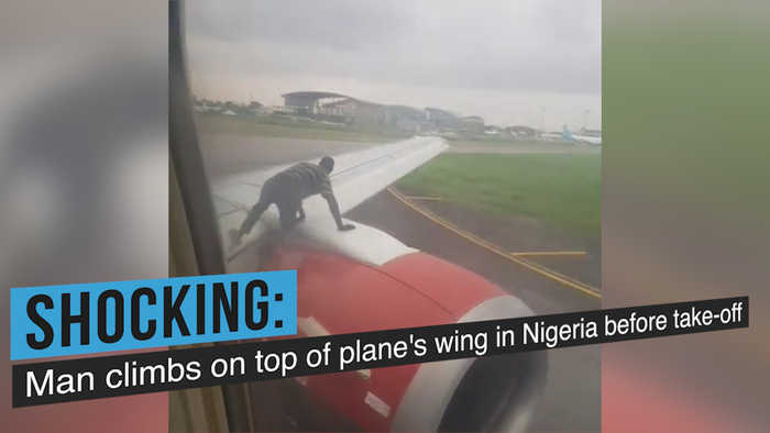 Man climbs on top of plane's wing before take-off