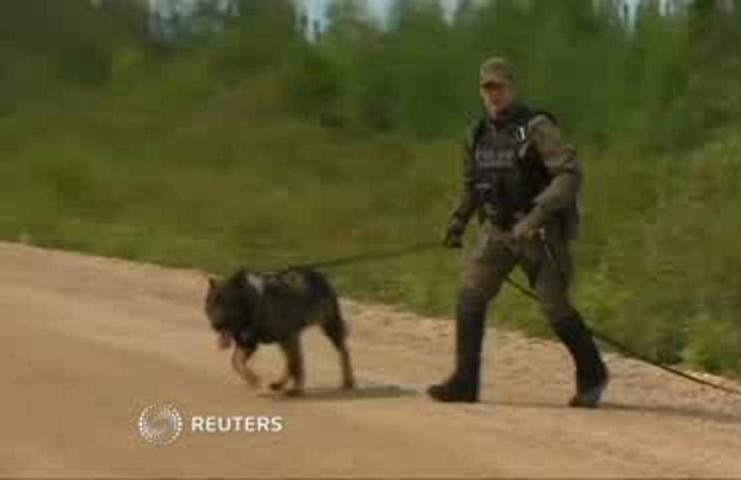 Canadian police scale down search for teen murder suspects