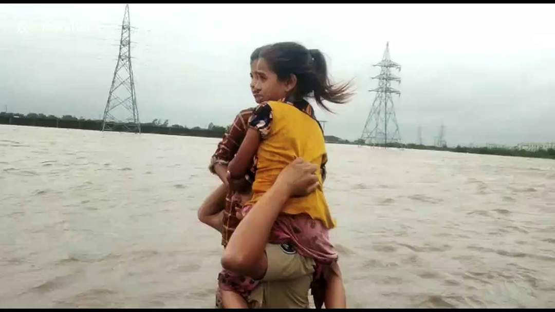 Policeman in India becomes viral sensation after carrying two children across 1.5 km river