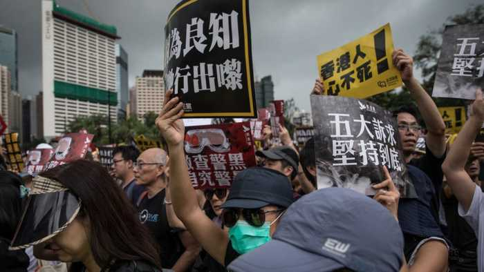 Hong Kong Protesters Hold Peaceful March After Chaotic Demonstrations