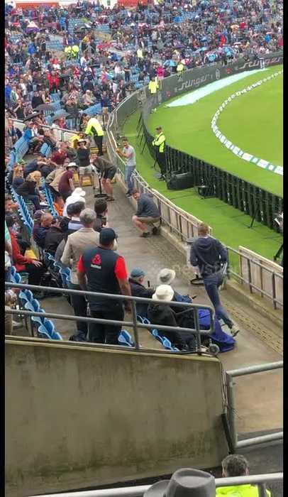 Funny clip shows fans in stands take part in their own game of cricket as rain stops play at Ashes Test match in Headingley