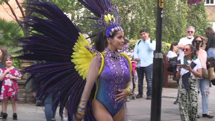 Samba dancer prepares for Notting Hill Carnival