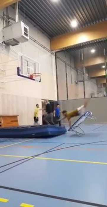 Guy Fails to Jump on Trampoline and Faceplants on Inflatable Mat