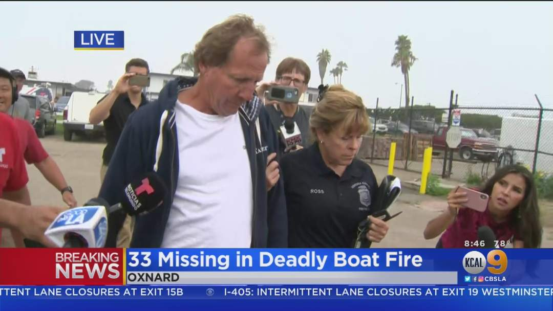 Injured Survivor Being Escorted After Santa Cruz Boat Fire