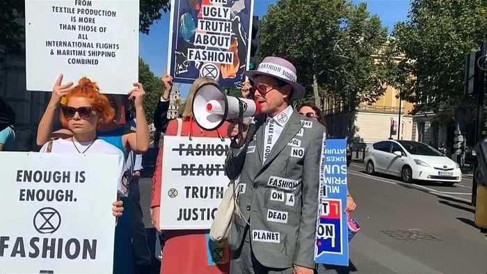 Environmental activists protest near Victoria Beckham London show