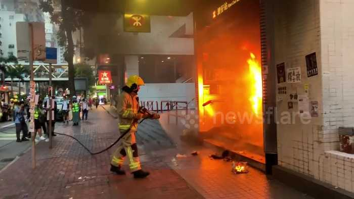 Firefighters put out blaze lit by Hong Kong protesters at Wan Chai station