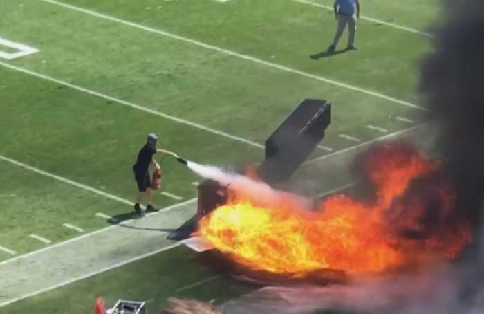 Fire burns on sideline before start of NFL game