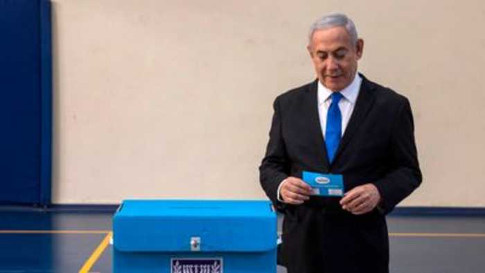 Netanyahu fights for political life as exit polls too close to call