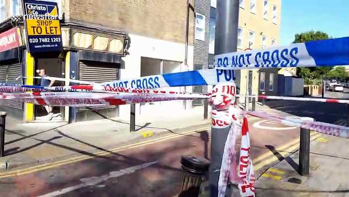 Police cordon off street in north London after shooting leaves woman in critical condition