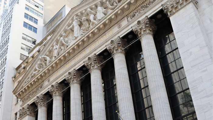 Stocks Fall, Treasury Yield Curve Flattens After Fed Cuts Rates