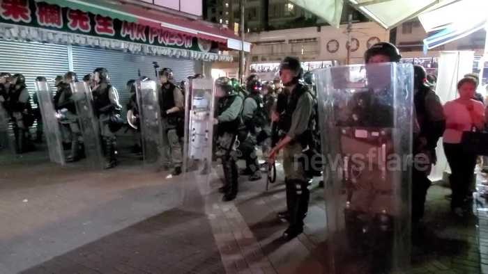 Hong Kong riot police move in on main road in Yuen Long after protest sit-in at nearby shopping mall