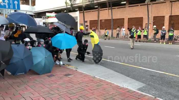 Hong Kong protesters take position behind wall of umbrellas ahead of confrontation with police