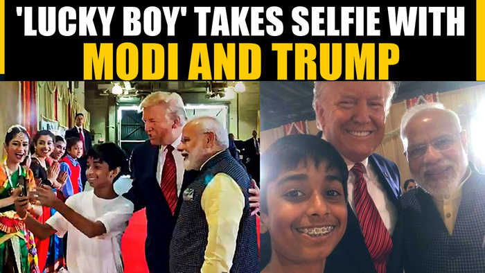 PM Modi and Pres Trump pose for a selfie with a young boy, Video goes viral | OneIndia News