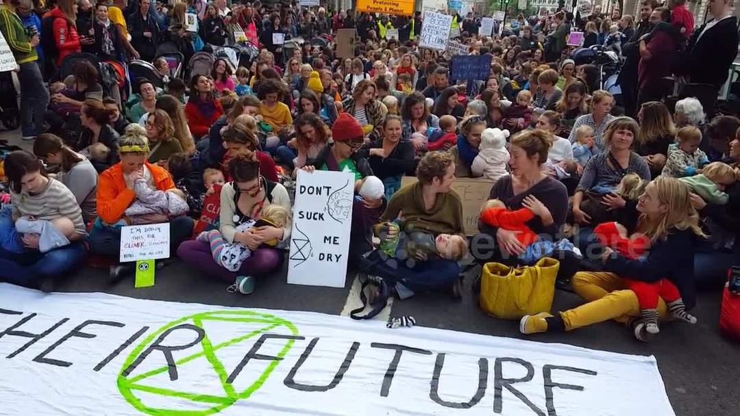 Mothers stage mass breastfeeding in London as Extinction Rebellion protests continue