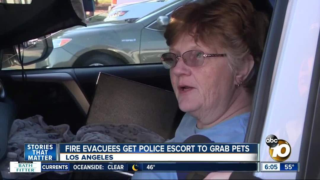 L.A. fire evacuees get police escort to grab pets