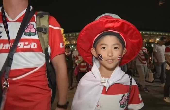 Japan fans jubilant over first trip to knockout stage