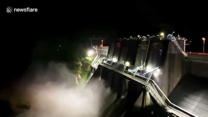Water gushes through dam as Typhoon Hagibis hits Japan