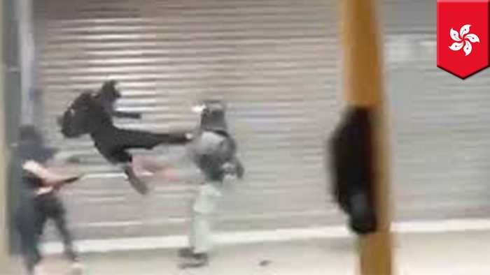Hong Kong protester destroys policeman with flying kick