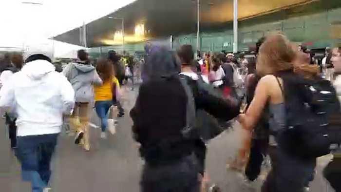 Catalan protestors flee as police begin crowd control