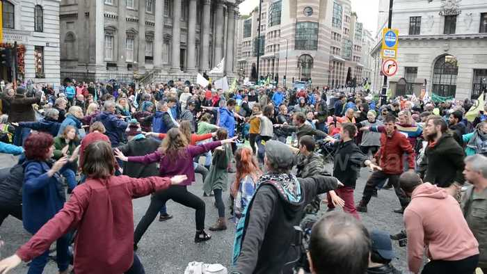 Extinction Rebellion protesters do yoga as second week of protests begin