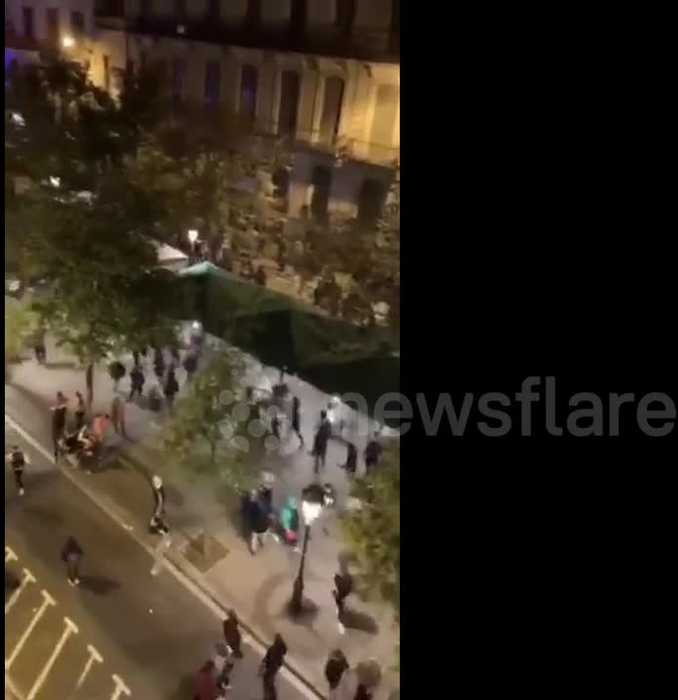 Catalan protestors throw chairs and glasses at riot police truck in running street battles