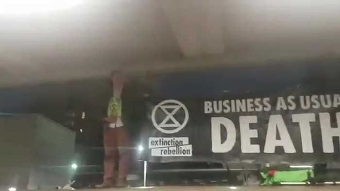 London commuters fight back after Extinction Rebellion protesters climb on top of Tube