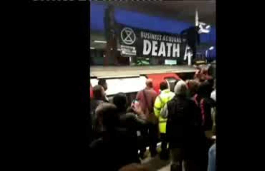 Commuters fight with climate change protesters as they disrupt London rail services