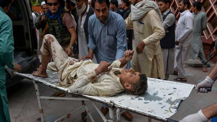 Blasts in Afghanistan mosque kill scores of worshippers