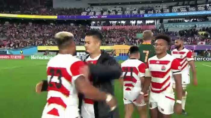 Japan players embrace after tough loss