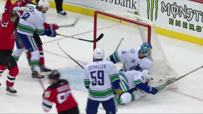 Jack Hughes scores first NHL goal in Devils win over brother Quinn's Canucks
