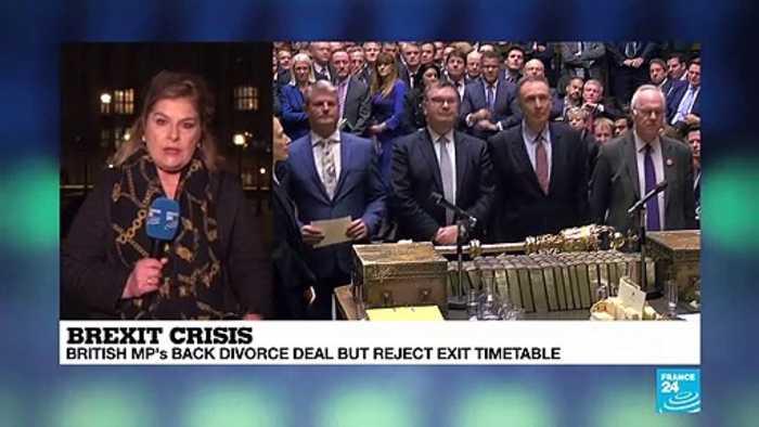 British MPs back divorce deal but reject exit timetable