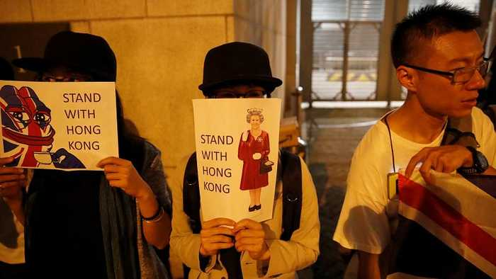 Activists form human chain at UK consulate in Hong Kong