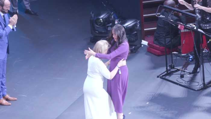 Meghan rejects curtsy in favour of a hug