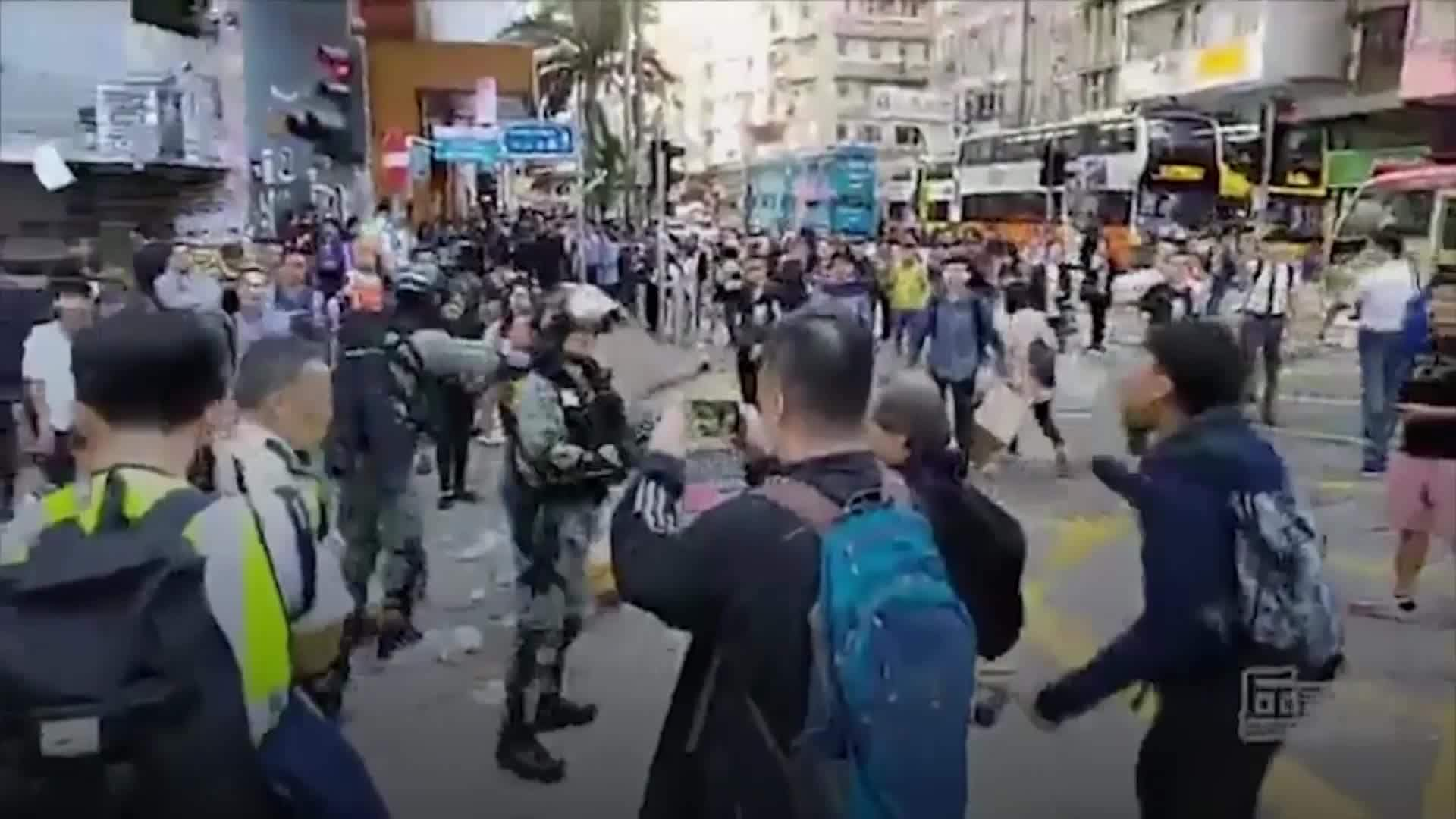 Police appear to shoot protester in Hong Kong
