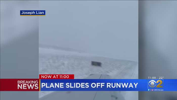 American Airlines Flight Slides Off Icy Runway At O'Hare Airport