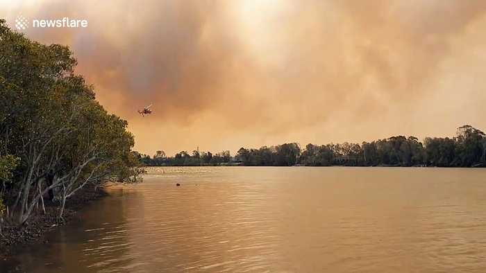 Skycrane helicopter fighting Australia bushfires refills water on the Manning River