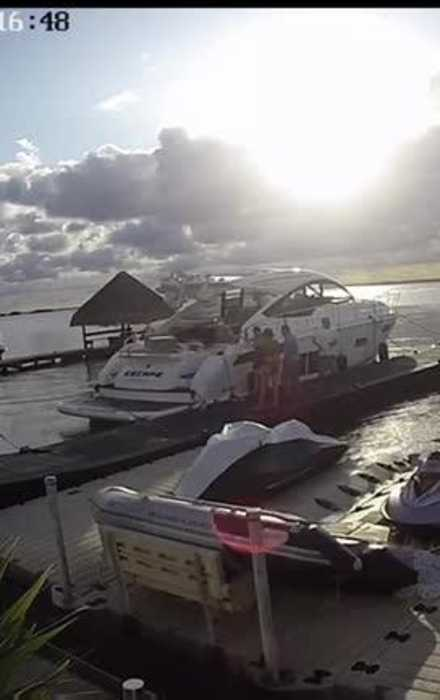 Boy Slips Down Boat Trying to Step on Walkway Pier