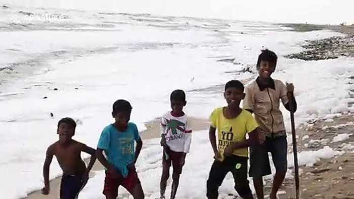 Children seen playing in 'toxic' foam blankets Indian beach