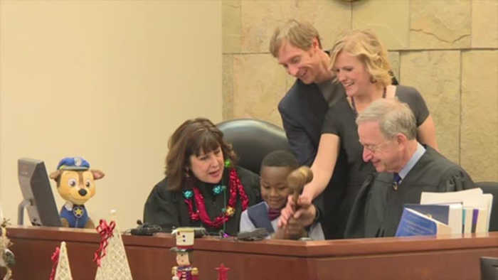 Boy invites kindergarten class to his adoption hearing