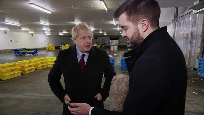 Boris takes reporters phone when shown photo