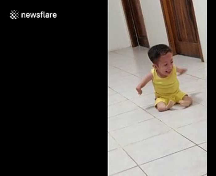 Heartwarming moment 'super capable' boy with medical conditions in Ecuador plays with his lovable puppy