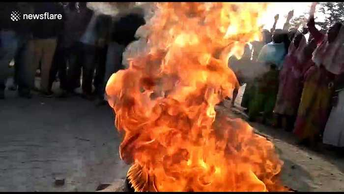 Tyres burned and police pelted with stones by protesters in Golaghat, India